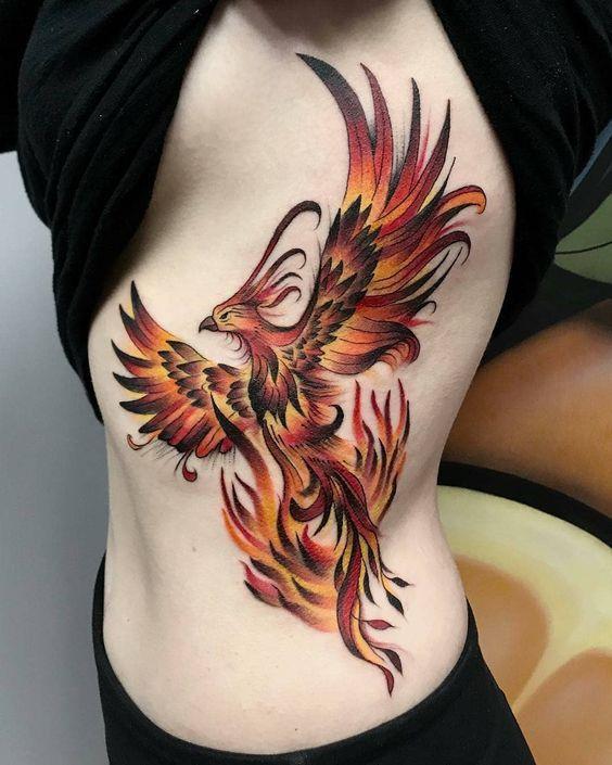 ave fenix tatuada