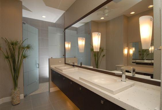 quartz countertops - thick!! Love Sort of vessel sink - flush with counter Lighting - spa look Mirror & lighting Dark cabinets