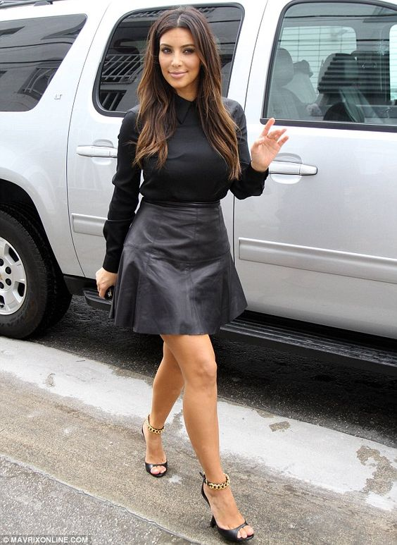 Leather look: Kim Kardashian shows off her figure in a flattering black leather outfit as she arrives at her Dash store in Miami                                                                                                                                                      More