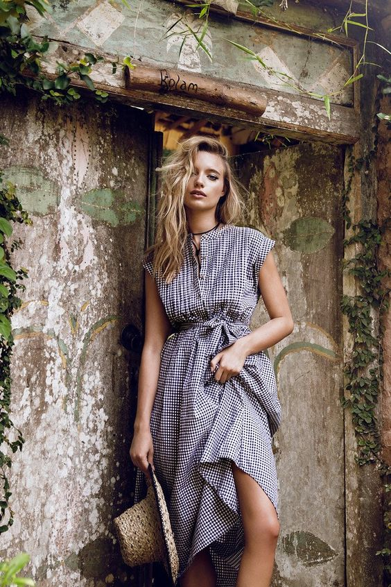 Cotton black and neutral gingham check shirt dress Pintuck detail at yoke. Button down front. Self tie belt.