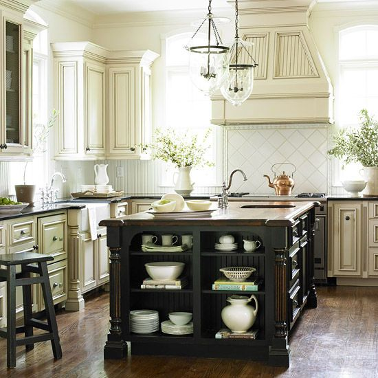 use this deb!!!!   I love a kitchen with white cabinets that have a dark glaze and an island either stained dark walnut or painted black. The cabinet doors and beadboard are fabulous.