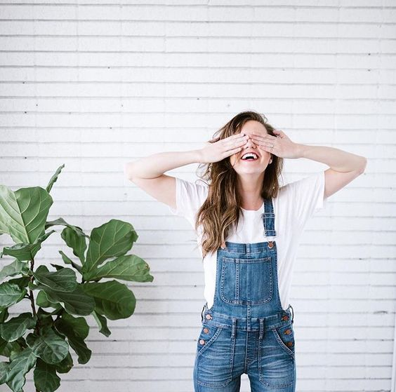Overalls and white tee.