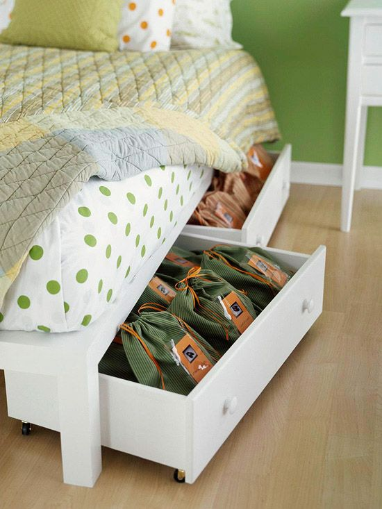Re-purposed dresser drawers with wheels for under the bed storage.  The article has over 20 bedroom storage solutions!