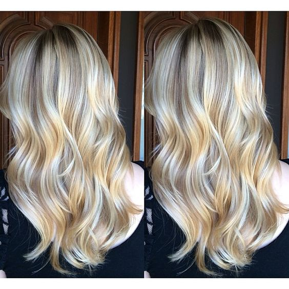 California Dreamin beach blonde hair. Balayage highlights over long loosely curled layers.