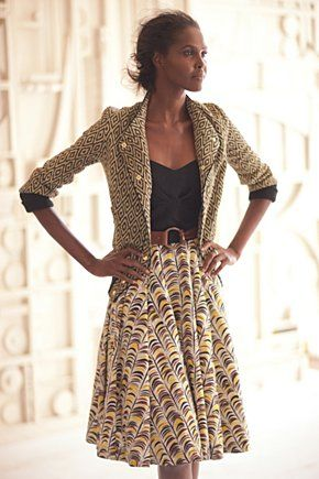 to carry your bohemian style at work, mix and match patterns with your sweaters and skirts/pants This is so my style!