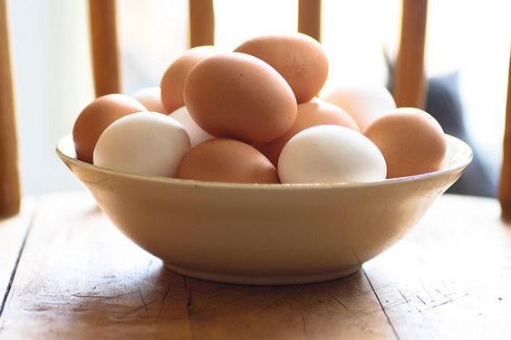 Vintage ceramic bowl with brown and white eggs