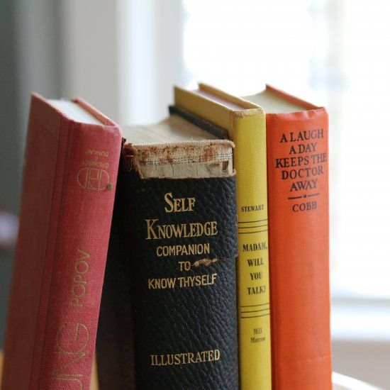 5 tips for using vintage books to bring color and character into your home decorating.