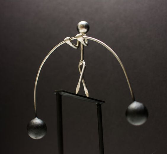 Ever feel our of balance the tightrope walker physics for Kinetic desk sculpture