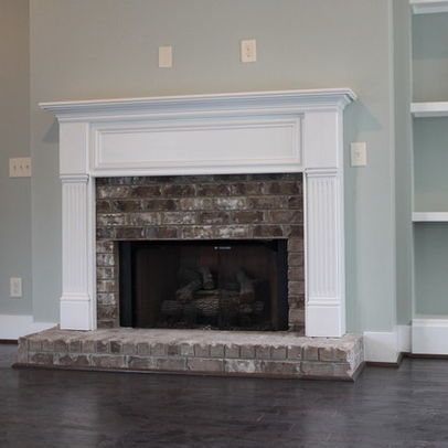 Fireplaces cabinets and white fireplace on pinterest for Brick fireplace white mantle