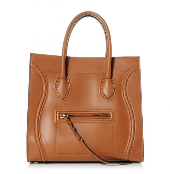 This is an authentic CELINE Natural Calfskin Small Phantom Luggage in Tan.   This is a stylish bag that is a large tote or a small piece of luggage crafted of luxurious leather.