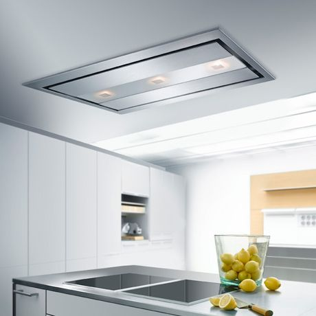 Modern minimalist design, total unobtrusiveness and powerful suction are main features of these ceiling kitchen hoods by Gutmann. Estrella II above and Campo II below are available in 5 sizes with subtle opal glass, halogen light and versatile perimetric extraction system that draws air in on all four sides of the hoods. The flush mounted ceiling hoods are operated by remote controls and all the ducting is hidden above the ceiling.