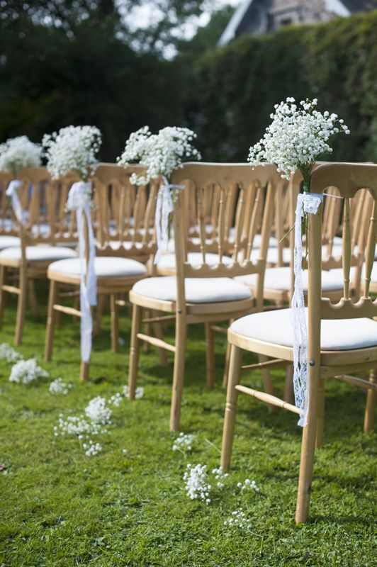 Simple and not too expensive aisle treatment. Baby's breath chair bouquets tied with Royal blue satin ribbon.