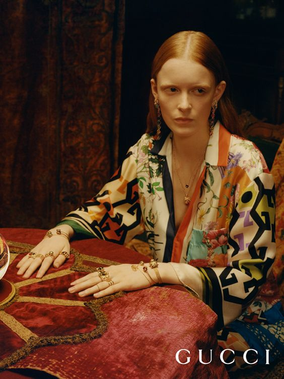 Shot by Colin Dodgson, the new Gucci Timepieces and Gucci Jewelry campaign is infused by a mysterious atmosphere. Seen here, richly decorated pieces from the fine jewelry Le Marchédes Merveilles collection including rings and earrings with feline head details in 18kt yellow gold, aquamarine and diamonds.  Creative Director: Alessandro Michele Art Director: Christopher Simmonds