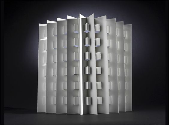 White cardboard window screen, to go in lower half of window. Privacy, filtered light, inexpensive design. From DesignTorget in Stockholm.