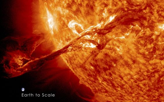 A long filament of solar material that had been hovering in the Sun's atmosphere erupts out into space