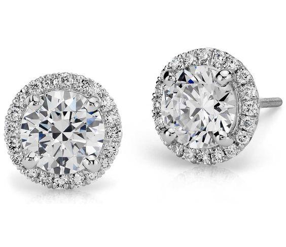 Every girl needs a pair of diamond studs! Halo diamond earring in platinum