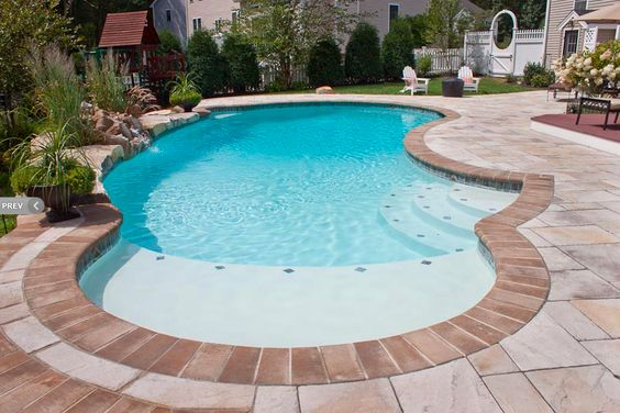 Gunite swimming pool with sun shelf northern pool spa for Pool design with sun shelf