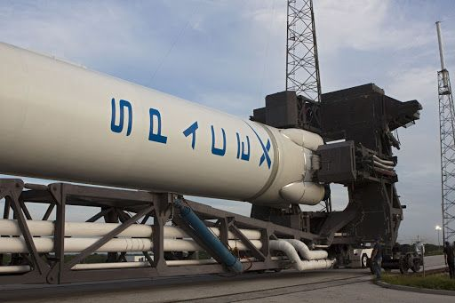The Space Exploration Technologies Or Spacex Falcon 9 Rocket Rolls Out Of Its Processing Hangar For A Wet D Spacex Space Exploration Technologies Spacex Falcon