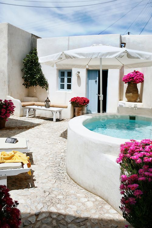 Santorini Patio Furniture: Traditional Greek Stone Tile Patio With Jacuzzi