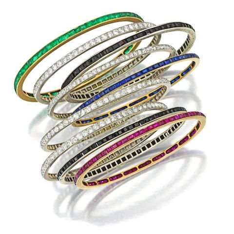 Lot 1 A COLLECTION OF DIAMOND AND GEM-SET BANGLE BRACELETS US$ 25,000 - 35,000