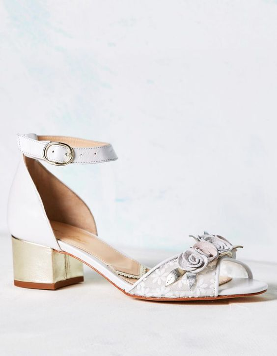 Tuscany is a beautiful satin sandal featuring a gold leather low block heel and soft...
