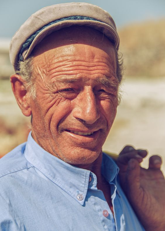 A charming old fellow in Santorini, Greece - Photo by Adam Allegro, http://catchthejiffy.com
