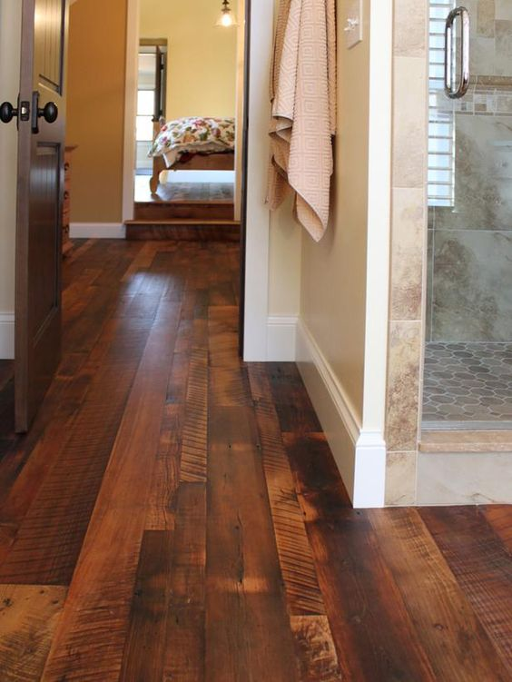 """""""A wood floor goes with absolutely everything,"""" states Tracy Martin Taylor, owner of the Dallas-based design firm Eleven 11 Design. While wood historically has been shunned from the steamy bath, today's homeowners are clamoring for the look and feel of reclaimed wood floors. Unlike the smooth, featureless planks found at a lumber yard, wood from old barns or salvage yards boasts visually compelling natural features. If treated properly, the wood can stand up to the moist environment…"""