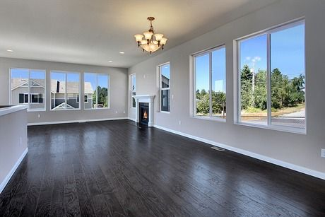 Large windows light this great room. We usually post furnished rooms -- Like this if you'd like to see more unfurnished new homes. Terrace T250 plan by Quadrant Homes in Federal Way, WA.