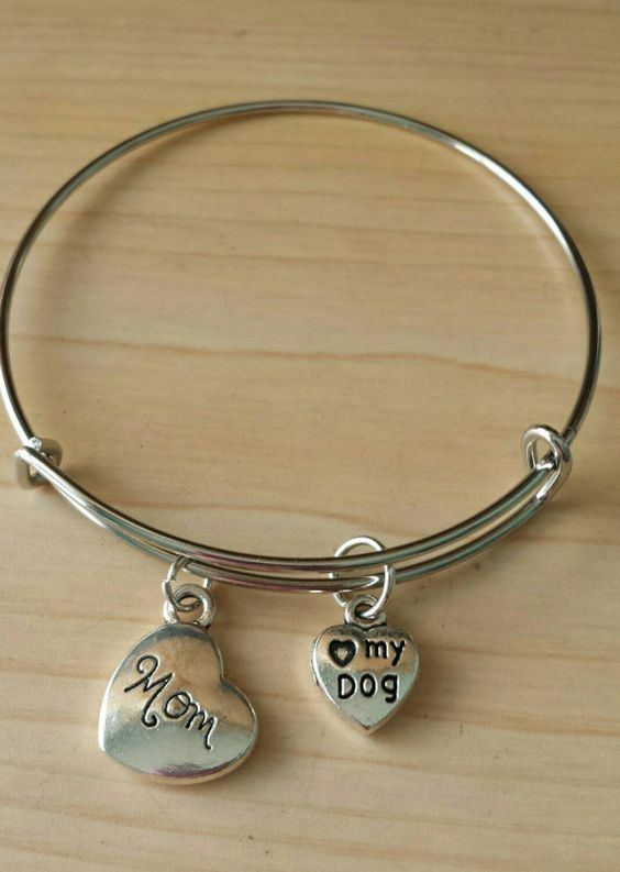 Check out this item in my Etsy shop https://www.etsy.com/listing/276769090/dog-mom-bangle-silver-plated-expandable
