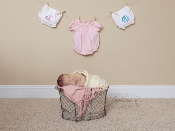 newborn with clothes line