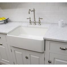 Constructed of fireclay, this large bathroom sink has a classic design and is already assembled for use. Featuring a polished white finish, this 23.25-inch sink has a unique farmhouse style.