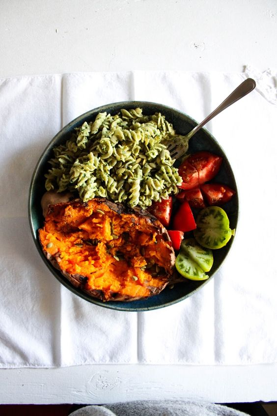 The Glow Bowl: bakes sweet potato with pesto pasta, tomatoes + pumpkin seeds / this rawsome vegan life