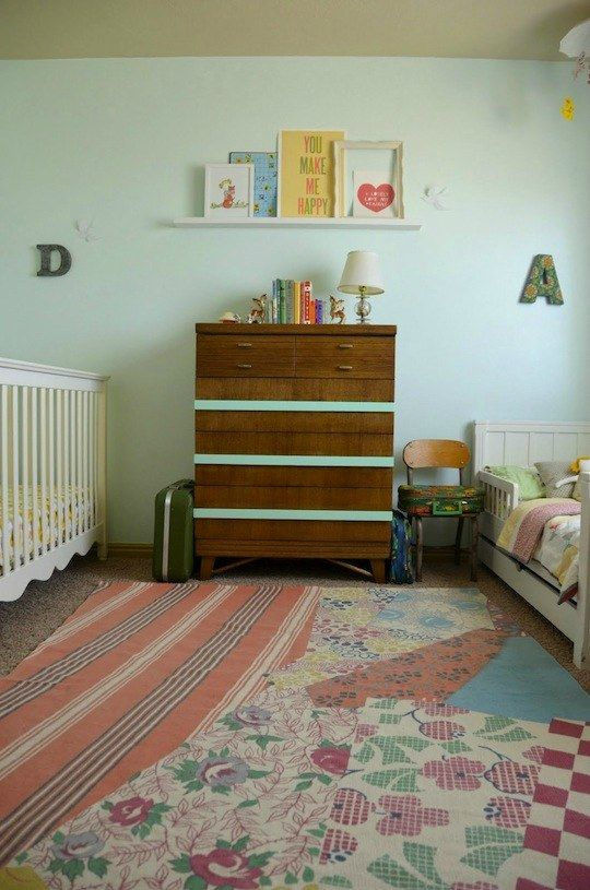 Something like this! You could paint white stripes on your grey wall, get a white dresser, and do that cute shelf with their baby pictures and a cute print. And don't get that hideous rug.