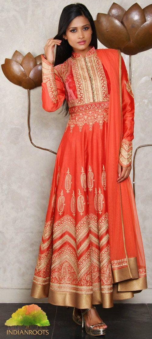 An elegant orange and gold chanderi silk anarkali suit with aari