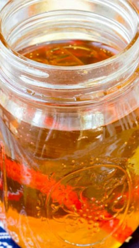 Quick Apple Pie Moonshine ~ a fun cocktail reminiscent of years past. This cocktail recipe, however, is made quickly and easily. It's slightly sweet and full of apple and cinnamon.