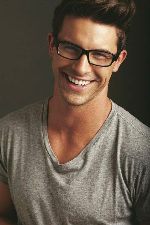 Gray v-neck tee, glasses and a sexy smile - simple and handsome