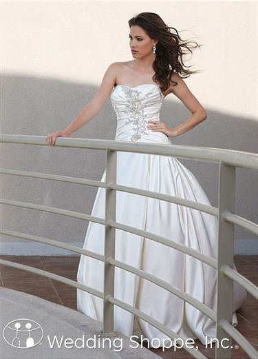 This is a. Beautiful dress with an inverted waistline