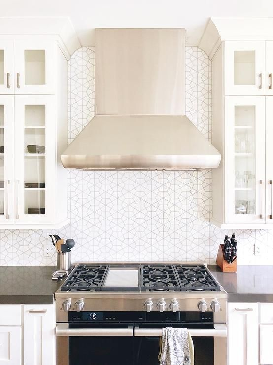 Transitional Kitchen Featuring A Cooktop Designed With A Black And
