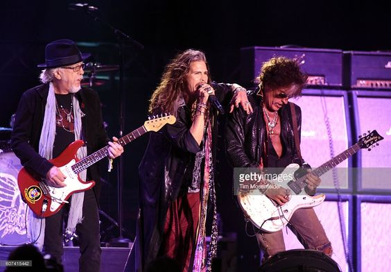 Brad Whitford, Steven Tyler, and Joe Perry of Aerosmith perform during the…