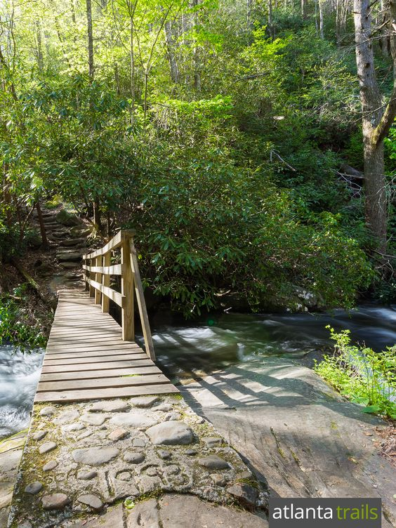 Hike the Hemlock Falls Trail at Lake Burton through a waterfall-filled valley