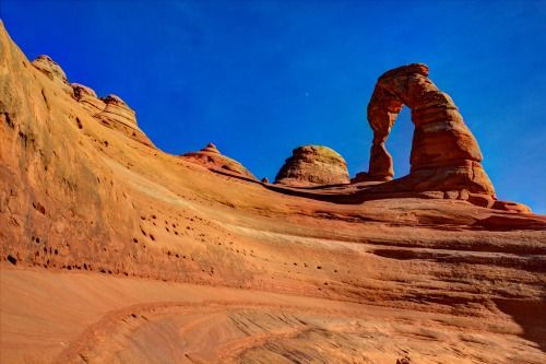 """A gorgeous shot of Arches National Park in Utah!  James Shoemaker captured this unique shot of Delicate Arch — one of the most photographed sites in the park. """"When you enter Arches National Park for the first time, you cannot be prepared for the grandeur of the rock formations, especially Delicate Arch,"""" James says."""