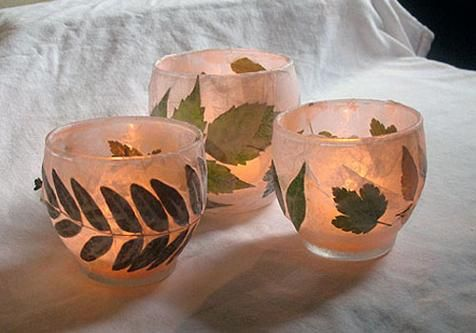 What you'll need:        Leaves and foliage      Glass votive holder or jar      White tissue paper      White craft glue      Water      Paintbrush      Tea light candles    How to make it:        Collect small leaves and other foliage from outside. Be sure there's still some life in the leaves – they shouldn't be too dry or crumbly. (Note: We found several of our leaves on bushes as their leaves are smaller.) Once selected, lay leaves in a single layer and place a large book on top to…