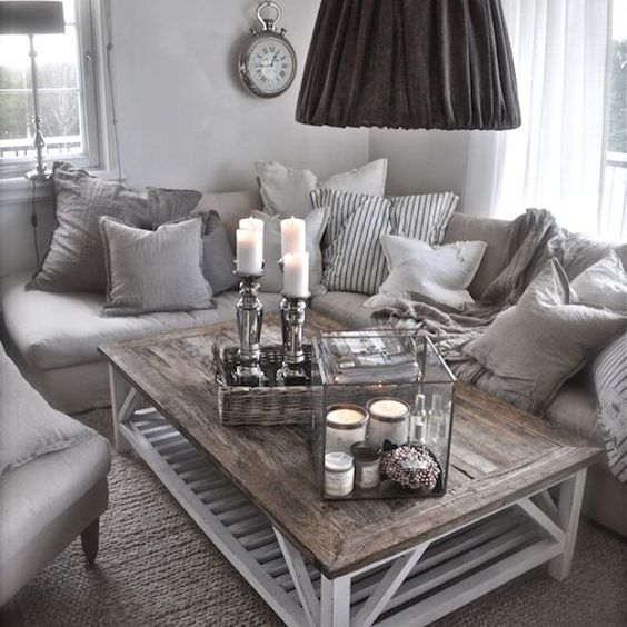 Love everything about this living room. Grey, Pillows #Livingroom #cozy #cocooning #homesweethome #pillows #grey #white #silver #candles #blankets