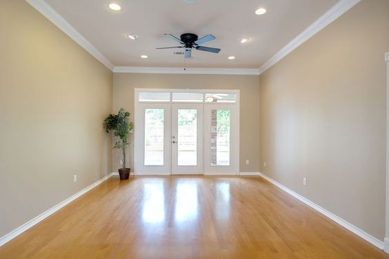 Wood Floors Crown Molding And Recessed Lights Combine To
