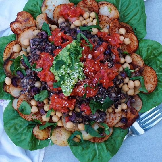 Stacks on Baked potatoes, chickpeas, #raw olive walnut 'mince', salsa and avocado #vegan