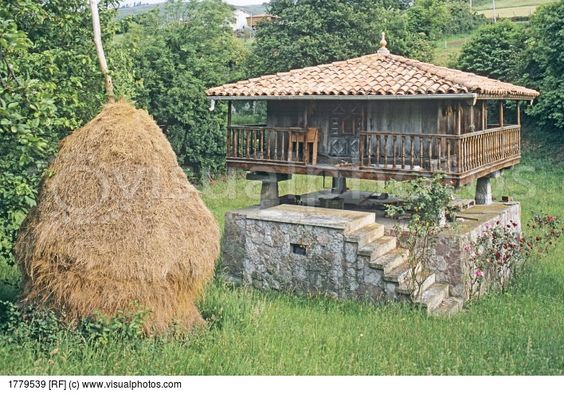 Traditional Stone Granary (Horreo) with Haystack in Asturias