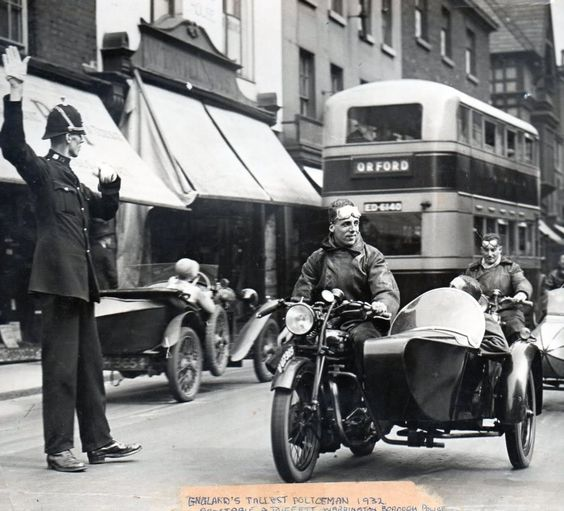 First bike in the photo is a Sunbeam outfit not sure of the second. This is my Great Uncle Albert who at the time was Englands tallest policeman he stood 6ft 9 & 1/2 inches in his bare feet  , picture shows him on traffic duty on Sankey Street, Warrington, England 1932