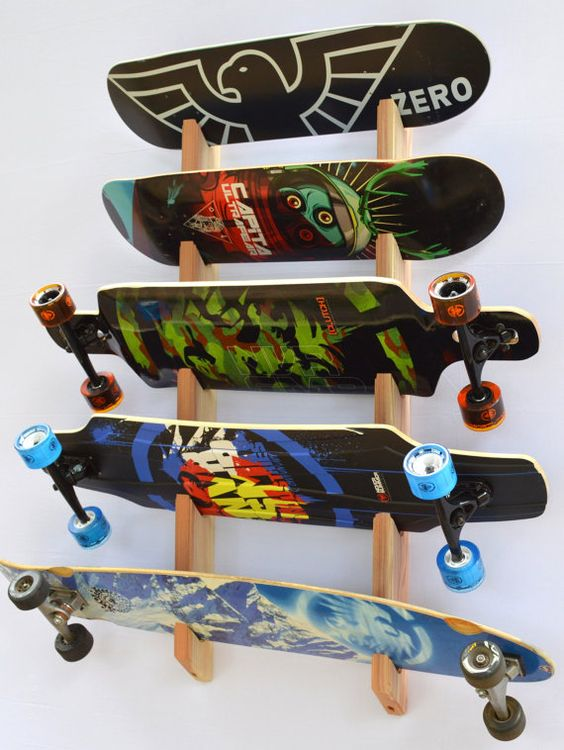 Store up to 5 of your snowboards or longboards in style with this attractive wall rack. This rack is handcrafted from premium pacific redwood which