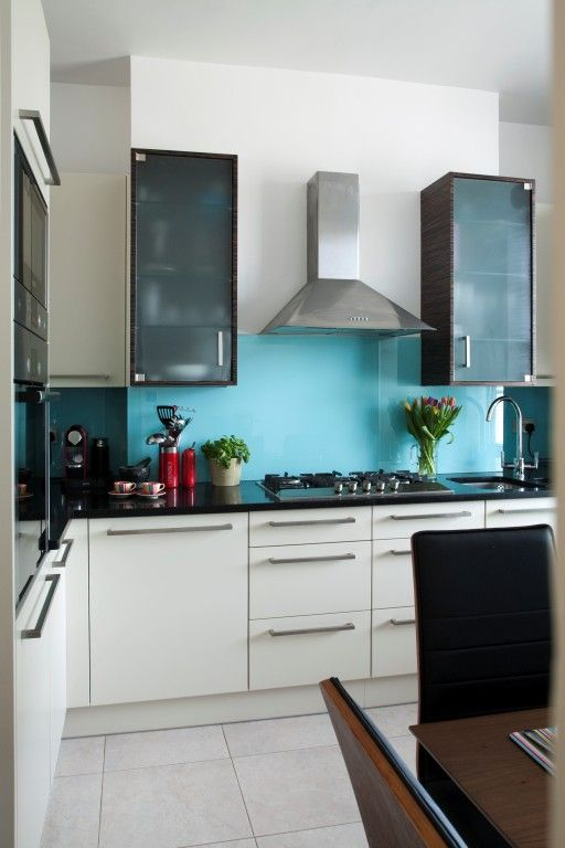 modern white kitchen with turquoise splashback