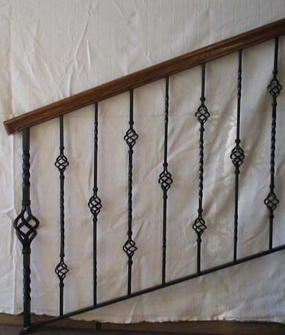 Iron indoor railing designs wood staircase interior for Interior iron railing designs
